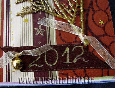 веточка и колокольчик на ленте с надписью фрагмент скрапбук странички о первом рождестве и новом годе новорожденной