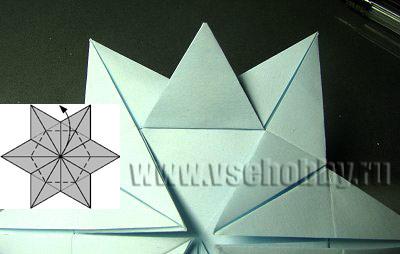 отгибаем лучик звезды делаем снежинку оригами своими руками