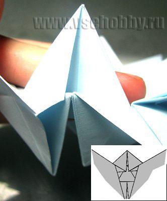 вытаскиваем уголочки делаем своими руками снежинку оригами