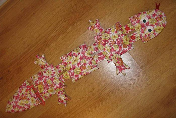 Развивающая игрушка Ящерица