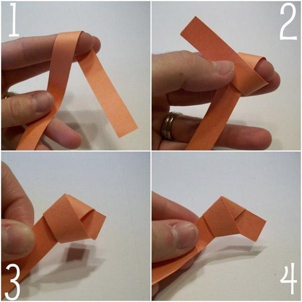 Делаем из ленты узелок - аккуратный пятиугольник