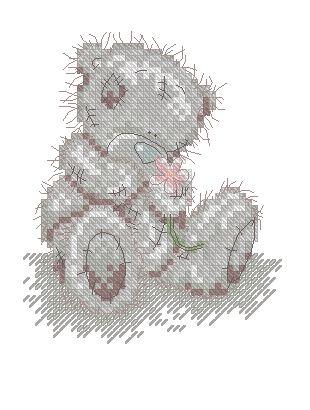 Медведь Тедди сидит с цветком