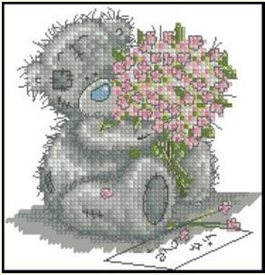 Медведь Тедди с букетом цветов