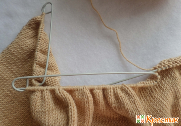 Снимите петли на булавки для вязания
