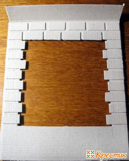 Приклеиваем клеем ПВА кирпичики на стену